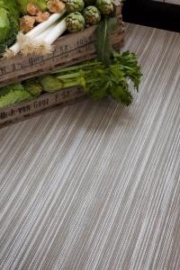 caja de verduras sobre alfombra de vinilo keplan linea de kp alfombras a medida