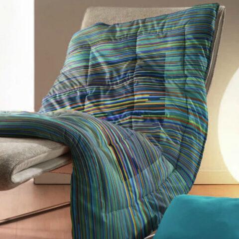 Plaid Zucchi flexy sobre una cómoda