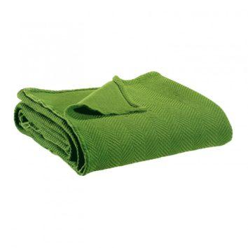 plaid boris vivaraise doblado color verde. Plaid sobre fondo blanco