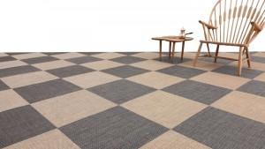 habitación enmoquetada con un damero de alfombra de vinilo keplan pixel de kp alfombras a medida