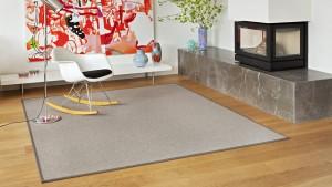 salón con alfombra a medida metrik kp