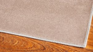 Detalle de cerca de alfombra de lana lanissima kp alfombras a medida en color beige