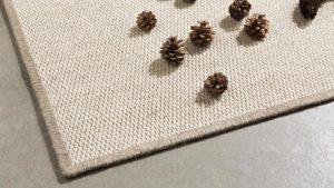 piñones sobre alfombra fina de lana eskila de kp alfombras a medida