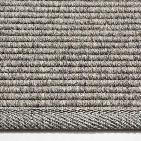 detalle ampliado de alfombra de lana eskila con remate strong de kp alfombras a medida