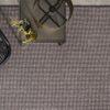 silla y mesita sobre alfombra de lana a medida woolmoon kp alfombras a medida