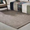 alfombras de sisal suiko kp alfombras a medida en un salón con butacas