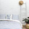 Ambiente con cama vestida con funda nórdica sisomdos palomo