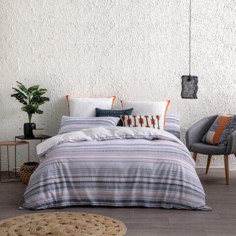 Ambiente con cama vestida con funda nórdica Kas australia markell